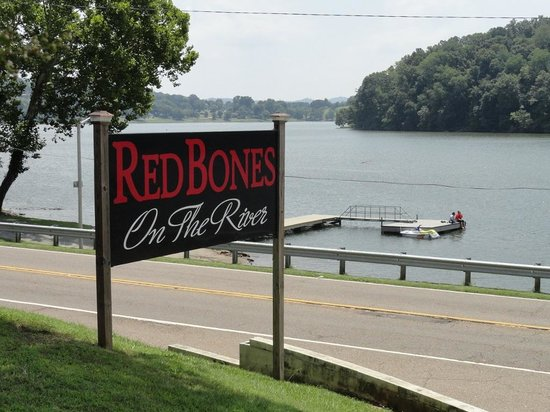 RedBones on the River: From the driveway - there are two patios that overlook the water