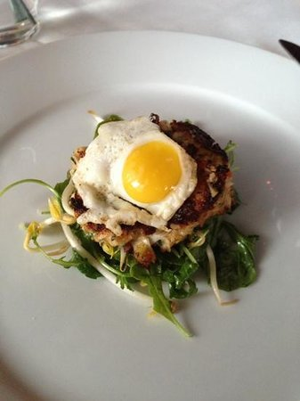 MAZA New American Cuisine: crab cake over arugula with quail egg in top