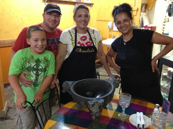 Amelia's Restaurant: Showing us the big bowl where they make their amazing salsa!