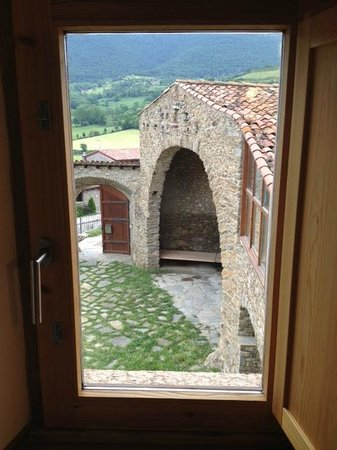 "Cal Calsot Casa Rural: View from one of the room windows. Under the arch there's a ""chill-out"" area."