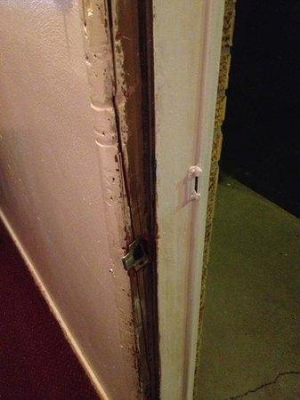 Chippewa Motel: Damaged door frame. Kinda scary