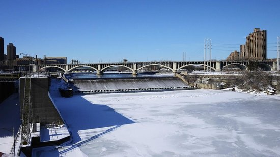 St. Anthony Falls: Waterfall in winter and...iced river