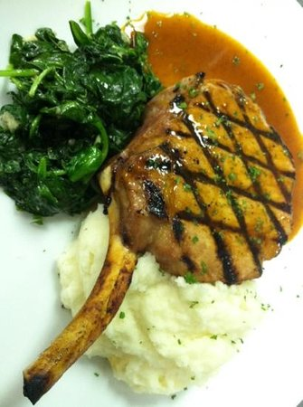 The Brickhouse Grill: Prime pork chop with sautéed spinach, mashed potatoes, & chipotle Demi-glacé.