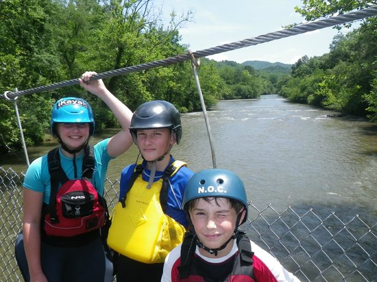 Nantahala Outdoor Center - Private Adventures : Liz, Loker and Kyle on walking bridge over Tennessee river