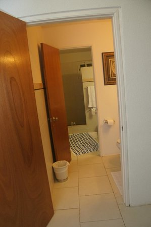 Turtle's Nest Beach Resort: shower at the end -- then, two toilets with door between them
