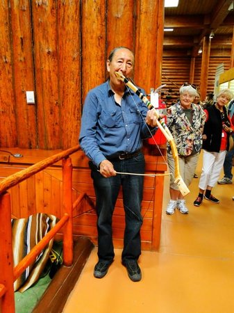 Buffalo Nations Luxton Museum : Helmer Plays Unusual Instrument