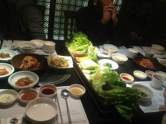 BenJia Korean Restaurant (JinLun Mansion) : Look at all these banchans! All free and filled up our whole table.
