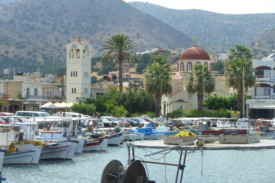 Olive Grove Apartments: Elounda harbour (OGA behind church with red roof)