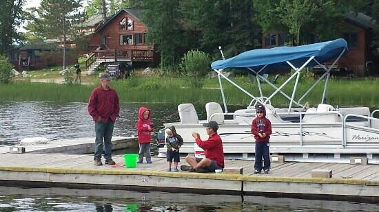 Vermilion Dam Lodge: the kids fishing with grandpa and dad
