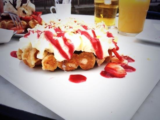 Waffle On: A basic waffle with cream, fresh fruit, nuts and raspberry sauce