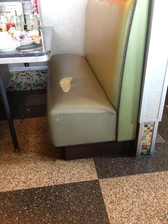 Eveready Diner: ripped seat in booth