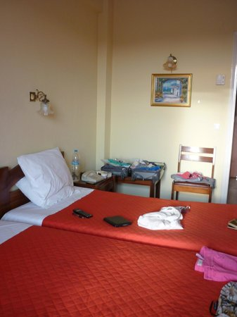 Sunset Hotel: clean room but very hard, uncomfortable beds & pillows