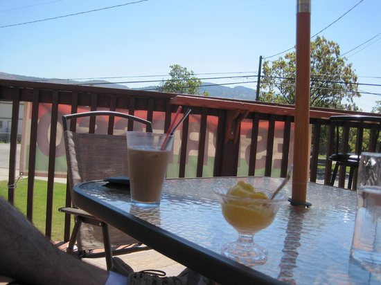 Medici's Gelateria: Enjoying our Iced Latte and Mango Sorbetto on the patio