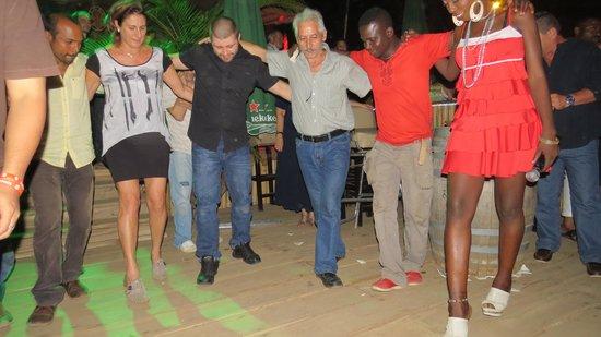 Secret Garden : Greek dance with Italian hostess in Africa!