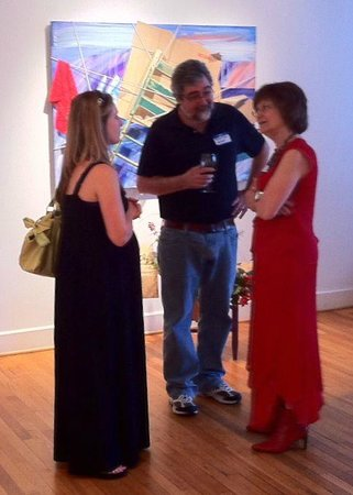 Black Mountain Center for the Arts: At an opening, artist Robert Tynes in front of his painting in the second-floor gallery.