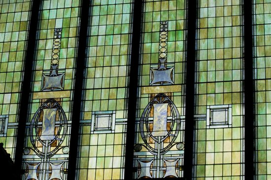 Prairie School Bank : Intricate stained glass arched windows