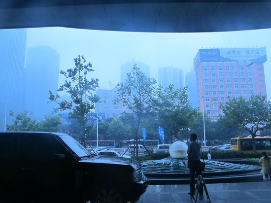 Crowne Plaza Qingdao: hotel entrance taken 230pm thats smog