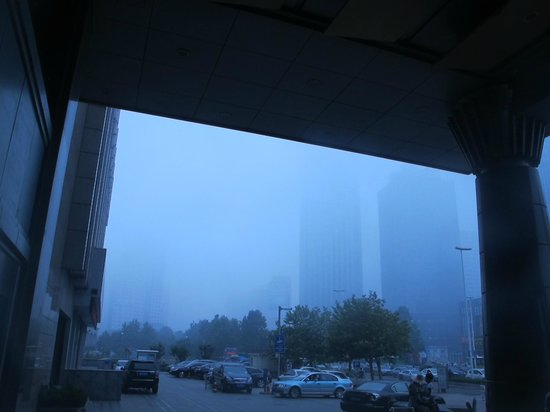Crowne Plaza Qingdao: hotel entrance , 230pm smog