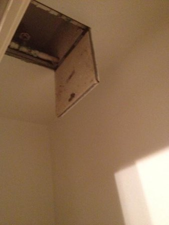 The Victorian Condominiums : In the second bedroom ceiling...some sort of water pipe with spicket...
