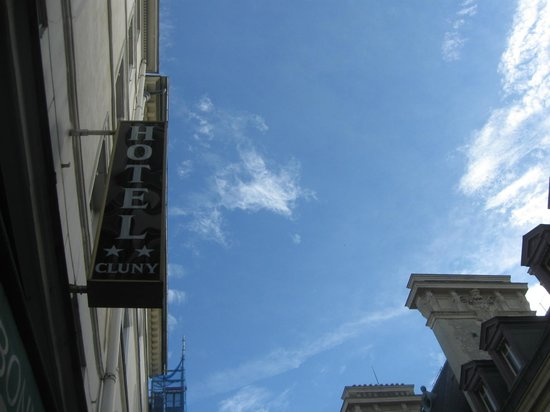 Hotel Cluny Sorbonne: Hotel signage beneath a lovely Paris summer sky