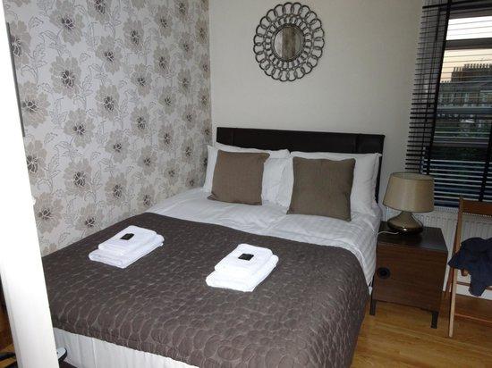Aviva Studio Apartments: View of Bed from door