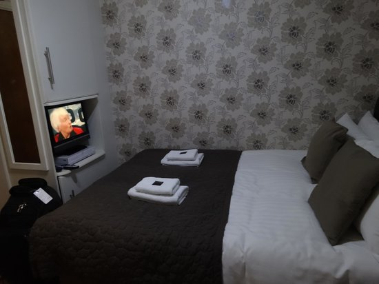 Aviva Studio Apartments: View of the Bed with the TV
