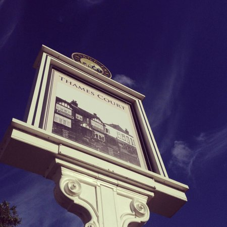 The Thames Court sign on a sunny evening
