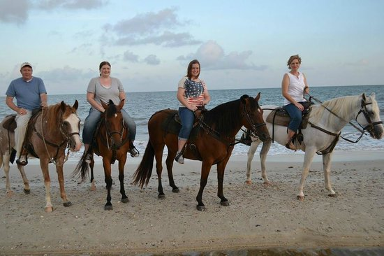Two-Bit Stable: Picture of the 4 of us on the beach