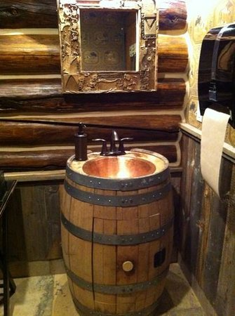 The Lodge and Spa at Brush Creek Ranch: Stylish ladies bathroom in the saloon