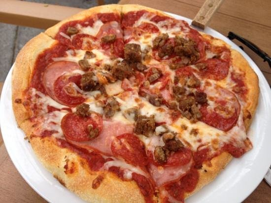 Lumberyard Rotisserie and Grill: meat lovers pizza