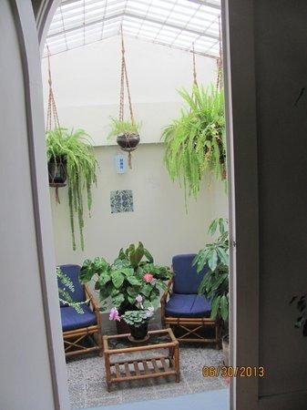 Hostal de La Rabida: Sitting area outside a room.