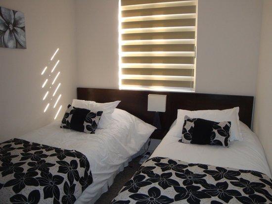 Alvavi Aparthotel Amunategui: quarto de solteiro, roupas de cama excelente