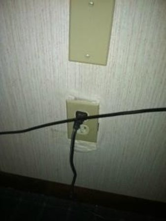 Quality Inn: You can see the outlet barely covers the holes in the wall.  Needs attention and updating!