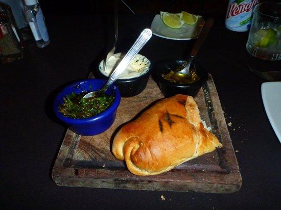 Al Pie de Carbon: Grilled bread, chimichurri, garlic butter and chilis
