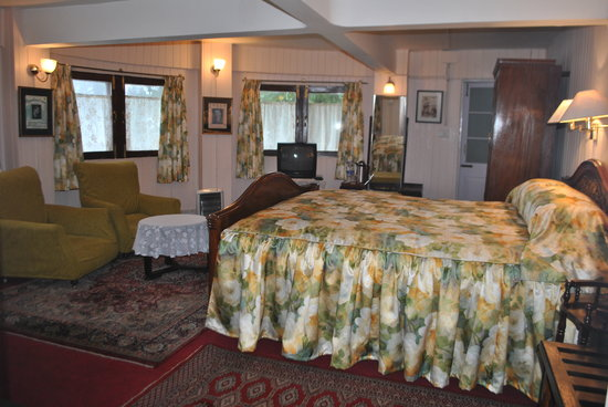 "Windamere Hotel: Colonial.""Forget-me-Not"" honeymoon suite, with semi-circular windows"