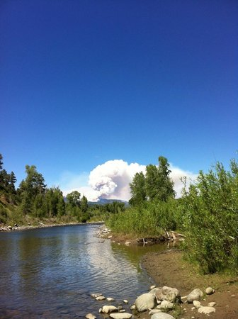 Pagosa Riverside Campground: View of the river.  The white was the fire in up in Wolf Creek Pass