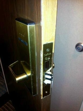 Crowne Plaza Columbus North-Worthington: door facing off and lock jimmed