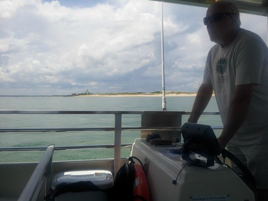Barnstable Harbor Ecotours: Captain Joe at the helm of the Horseshoe Crab, the Eco Tour's boat