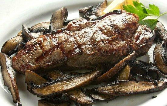 Our Bistecca: prime sirloin steak grilled, with Portobello mushrooms sauteed in olive oil