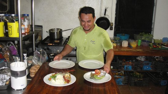 KayaSol Restaurant: Setting up for orders to go out...yes this kitchen is hot...its the tropics