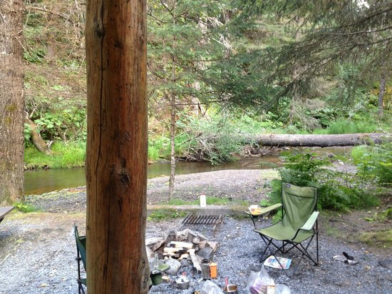 Alaska Creekside Cabins: View of fire pit and creek from the porch of Spring Cabin