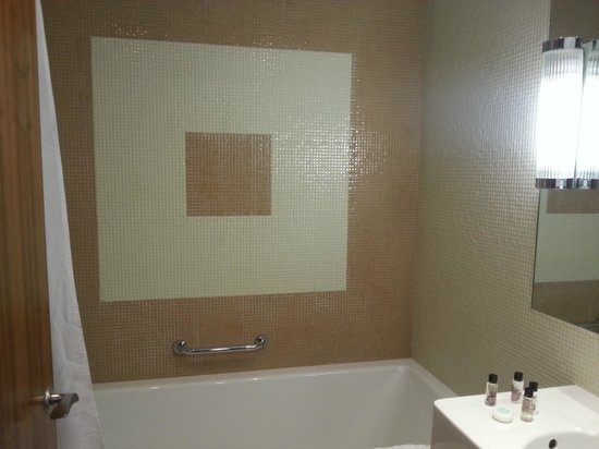The New Ellington: large modern bathroom well lit