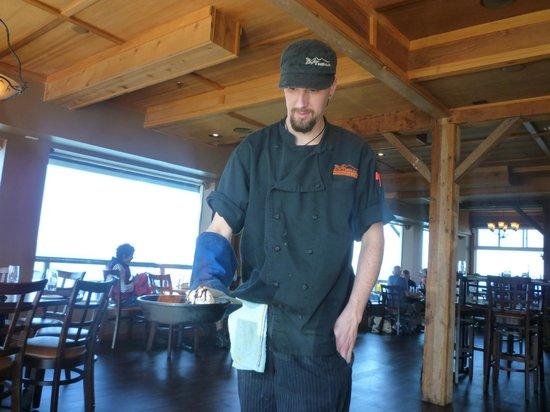 Chef lights the Half Baked Alaska