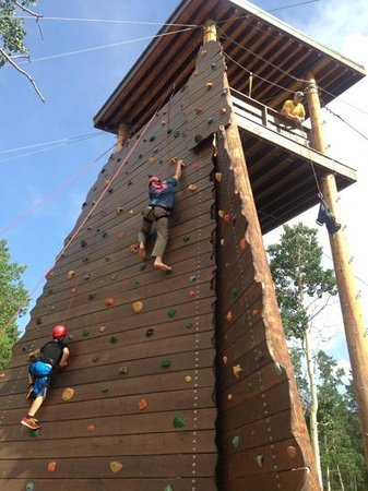 Wind River Christian Family Dude Ranch: rock wall and zip line fun