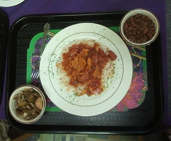 Le' Pam's House of Creole: A yummy creole dish over rice with sides of green beans with potatoes and red beans and rice.
