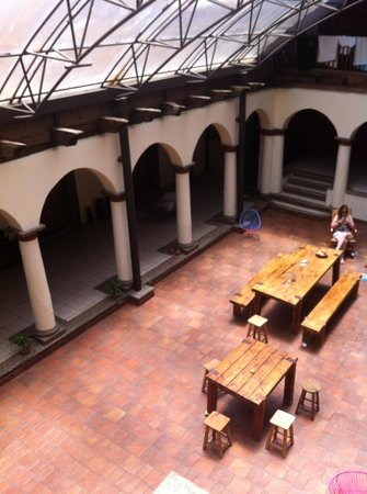 Puerta Vieja Hostel: common area; rooms surround this on first and second level