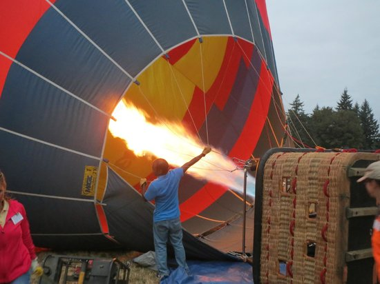 Vista Balloon Adventures: Gas is pumped into the balloon to stand it upright