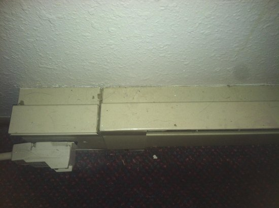 Relax Inn Motel: Hair and dirt on heater baseboard