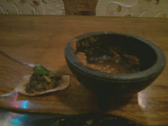 Rancho Grande: Excess cilantro piled on half a tortilla chip from this tiny bowl of salsa
