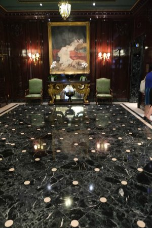 Lift lobby area with marble floor and painting